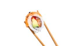 Holding fresh maki sushi roll Royalty Free Stock Photo