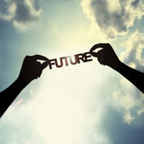 Holding future in sky Royalty Free Stock Images