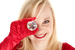 Holding gem to eye Stock Photos