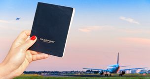 Holding a generic passport with one airplane taxiing and another taking off Stock Image