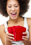 Holding a gift Royalty Free Stock Photo