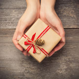 Holding a gift box Royalty Free Stock Image