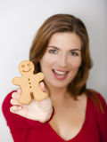 Holding a Gingerbread cookie Royalty Free Stock Images