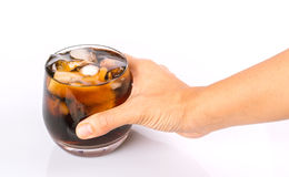 Holding A Glass of Cola Drink Royalty Free Stock Photography