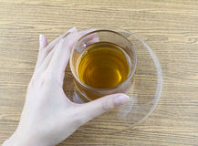 Holding a glass cup tea Stock Photo