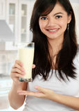 Holding a glass of milk Stock Photography