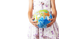 Holding globe. Girl holding a globe in her hand Royalty Free Stock Images