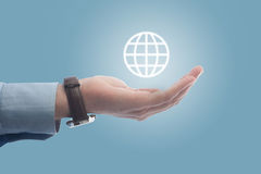 Holding the globe royalty free stock photography