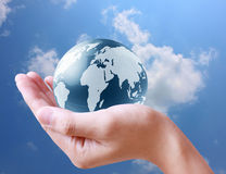 Holding globe in his hand Royalty Free Stock Photo