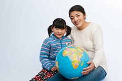 Oriental mothers and daughters Stock Image
