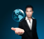 Holding a glowing. Holding a glowing earth globe in his hands Royalty Free Stock Image
