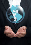 Holding a glowing earth. Holding a glowing earth globe in his hands Stock Photo