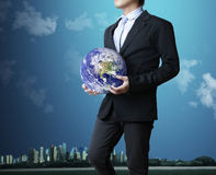 Holding a glowing earth globe Stock Photo