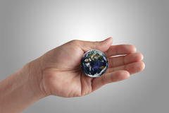 Holding a glowing earth globe Stock Photos