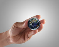 Holding a glowing earth globe Royalty Free Stock Photography