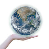 Holding a glowing earth globe in hand Stock Image