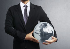 Holding a glowing earth globe in his hand Royalty Free Stock Photography