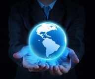 Holding a glowing earth globe in his hands Stock Image