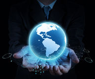 Holding a glowing earth globe in his hands Stock Photo