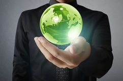 Holding a glowing earth globe in his hands. Earth image provided Stock Photos