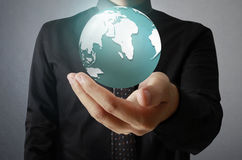 Holding a glowing earth globe in his hands. Earth image provided Stock Photography