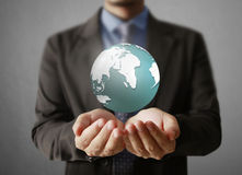 Holding a glowing earth globe in his hands. Earth image provided Royalty Free Stock Image