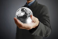Holding a glowing earth globe in his hands. Earth image provided Royalty Free Stock Photo
