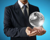 Holding a glowing earth globe in his hands. Earth image provided Stock Image