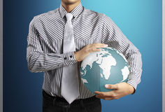 Holding a glowing earth globe in his hands . Extremely detailed Stock Images