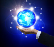 Holding a glowing earth globe in his hands Royalty Free Stock Image