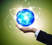 Holding a glowing earth globe in his hands Stock Images
