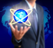 Holding a glowing earth globe in his hands Stock Photos