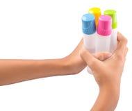 Holding Glue Bottles I Stock Photos