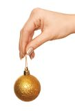 Holding gold Christmas ball Stock Photos
