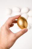 Holding a golden egg Royalty Free Stock Image