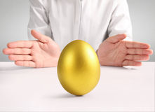 Holding Of Golden Eggs Stock Image