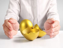 Holding of golden eggs Royalty Free Stock Images