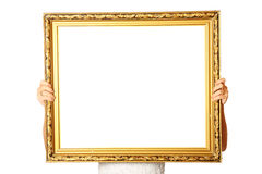Holding golden frame Royalty Free Stock Photo