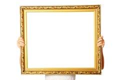 Holding golden frame Royalty Free Stock Photo