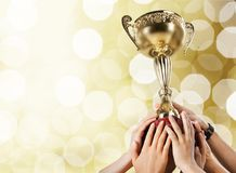 Hands holding golden trophy on light background. Holding golden hands trophy leisure activity cut out human hands royalty free stock image