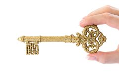 Holding a Golden Key Stock Photos
