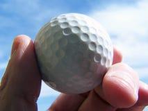 Holding golf ball royalty free stock photo