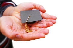 Holding graduation cap Stock Images