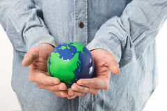 holding a green earth Royalty Free Stock Image