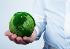 Holding a green earth. Hand holding a green earth Stock Photos