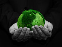Holding a green earth. Hand holding a green earth Royalty Free Stock Photos