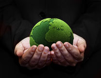 Holding a green earth. Hands holding a green earth Royalty Free Stock Photos
