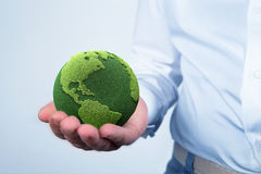 Holding a green earth Stock Image