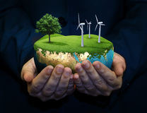 Holding a green earth. Hand holding a green earth Royalty Free Stock Images