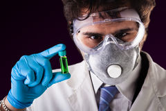 Holding a green vial Royalty Free Stock Images